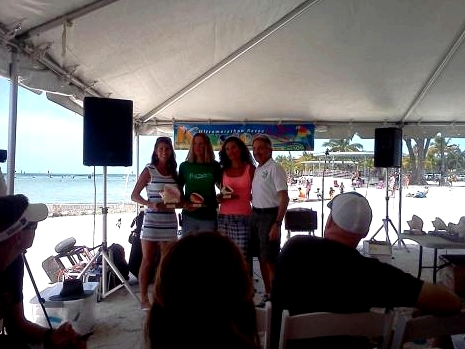 The Keys 100 awards ceremony. From left to right: Alyson Venti, 1st overall; Traci Falbo, 3rd overall; Katalin Nagy, 4th overall; race director Bob Bcker.